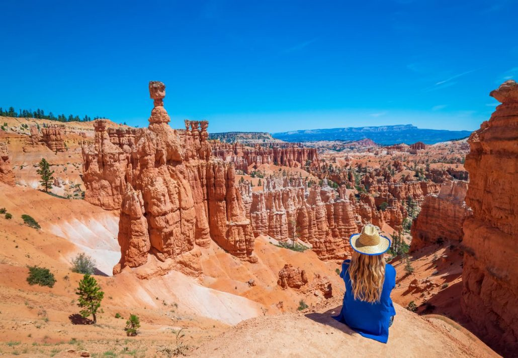 A young woman travels Bryce Canyon national park in Utah, United States.
